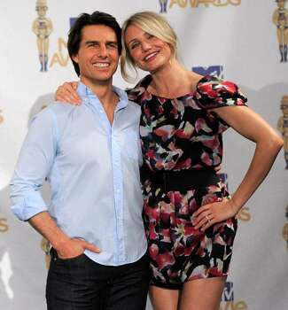 Cameron Diaz, right, and Tom Cruise are seen backstage at the MTV Movie Awards in Universal City, Calif., on Sunday, June 6, 2010. (AP Photo/Chris Pizzello) Photo: Chris Pizzello