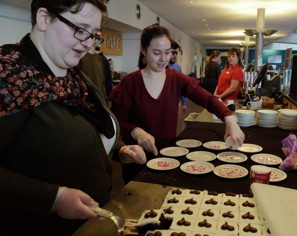RPI volunteer students, junior Anastasia Feraco, left, and sophomore Maya Ooki prepare desserts at Evelyn's Cafe during the RPI Student Club Terra Cafe on Wednesday, Feb. 14, 2018, in Troy, N.Y. The club revolves around sustainable and ecologically friendly food, and offers omnivore, vegetarian and vegan options. (Paul Buckowski/Times Union)