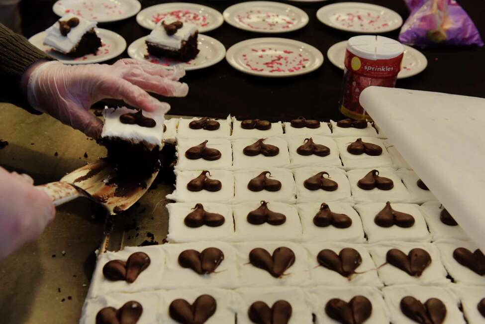 RPI volunteer student, junior Anastasia Feraco, prepares desserts at Evelyn's Cafe during the RPI Student Club Terra Cafe on Wednesday, Feb. 14, 2018, in Troy, N.Y. The club revolves around sustainable and ecologically friendly food, and offers omnivore, vegetarian and vegan options. (Paul Buckowski/Times Union)