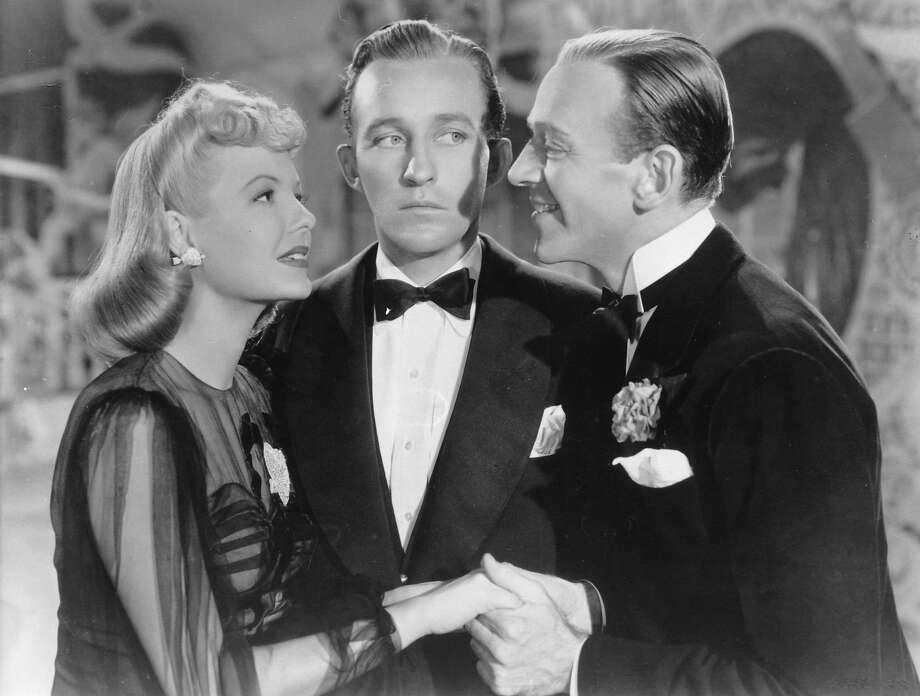"Majorie Reynolds, left, Bing Crosby and Fred Astaire in ""Holiday Inn."" Photo: Ullstein Bild, Ullstein Bild Via Getty Images"