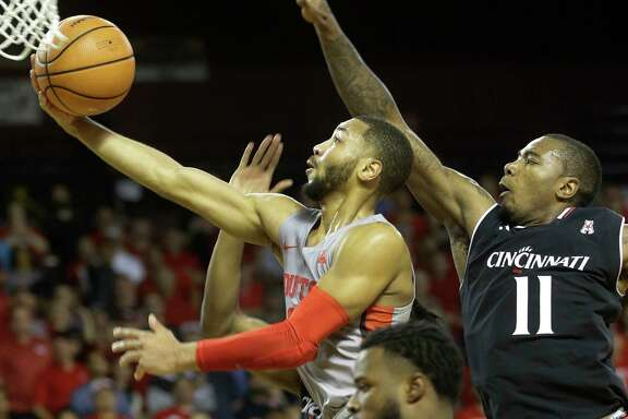 University of Houston Galen Robinson Jr. shoots past and the University of Cincinnati Gary Clark during the first half of game at Texas Southern University Thursday, Feb. 15, 2018, in Houston. ( Melissa Phillip / Houston Chronicle )