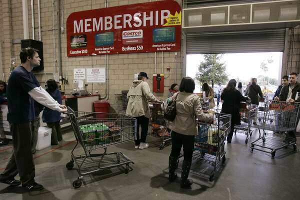 Shoppers leave a Costco in Mountain View, Calif., Sunday, Feb. 22, 2009. Costco Wholesale Corp. said Wednesday, March 4, 2009, that its fiscal second-quarter profit fell 27 percent partly on lower non-foods sales and some deeper discounting, while the stronger dollar and falling gas prices took a toll on same-store sales. (AP Photo/Paul Sakuma)