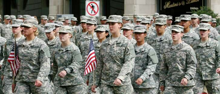 Members of the U.S. Army march Nov. 9, 2013 during the 13th annual Veterans Parade in downtown San Antonio, Texas. (For the Express-News)