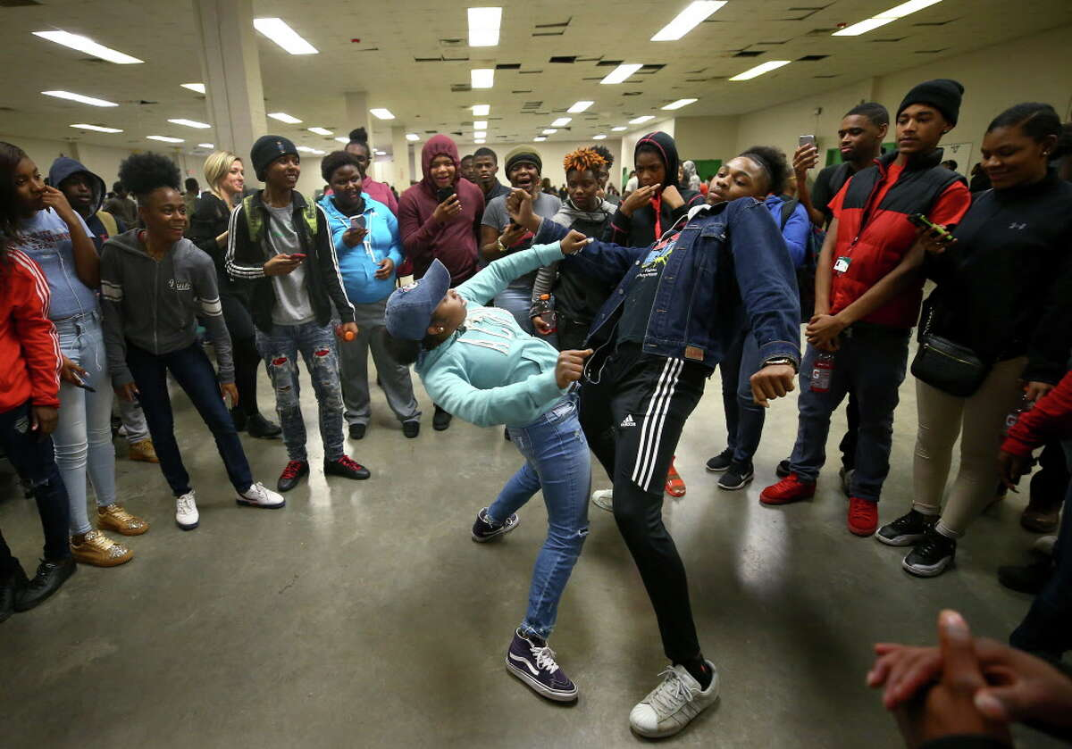 Worthing High School students Marquijonae Whit and Darius Scott show their dance moves during the first Police Officer Appreciation Luncheon Wednesday, Feb. 21, 2018, in Houston. The school has partnered with the police department in an effort to increase positive interaction between students and officers.
