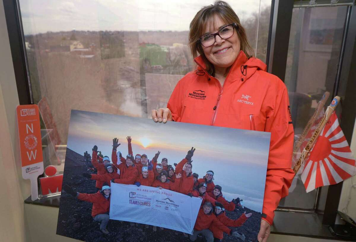 Alicia O'Neill, Director of Partnerships and Business Development at the Norwalk-based cancer nonprofit, the Multiple Myeloma Research Foundation, Friday, February 16, 2018, in the MMRF offices in Norwalk, Conn. O'Neill has been helping the cancer patients who have suffered from Myeloma climb mountains and complete other athletic milestones for the past three years and plans to take a group to climb Mt. Everest next month.