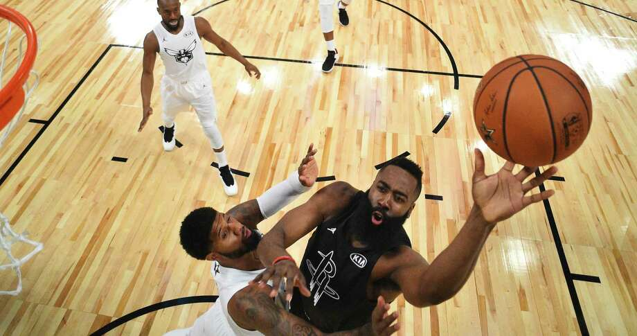 Team Stephen's James Harden, right, of the Houston Rockets, shoots as Team LeBron's Paul George, of the Oklahoma City Thunder, defends during the second half of an NBA All-Star basketball game, Sunday, Feb. 18, 2018, in Los Angeles. (Bob Donnan via AP, Pool) Photo: Bob Donnan, POOL / POOL USA TODAY Sports Images