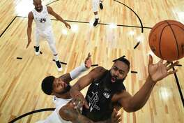 Team Stephen's James Harden, right, of the Houston Rockets, shoots as Team LeBron's Paul George, of the Oklahoma City Thunder, defends during the second half of an NBA All-Star basketball game, Sunday, Feb. 18, 2018, in Los Angeles. (Bob Donnan via AP, Pool)