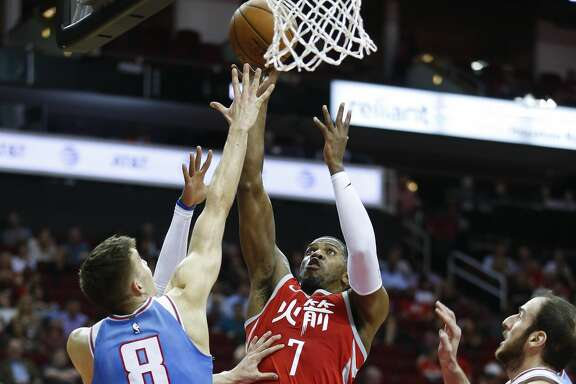 Houston Rockets guard Joe Johnson (7) attempts to lay up the ball over Sacramento Kings guard Bogdan Bogdanovic (8) as the Houston Rockets take on the Sacramento Kings at the Toyota Center Wednesday, Feb. 14, 2018 in Houston. (Michael Ciaglo / Houston Chronicle)