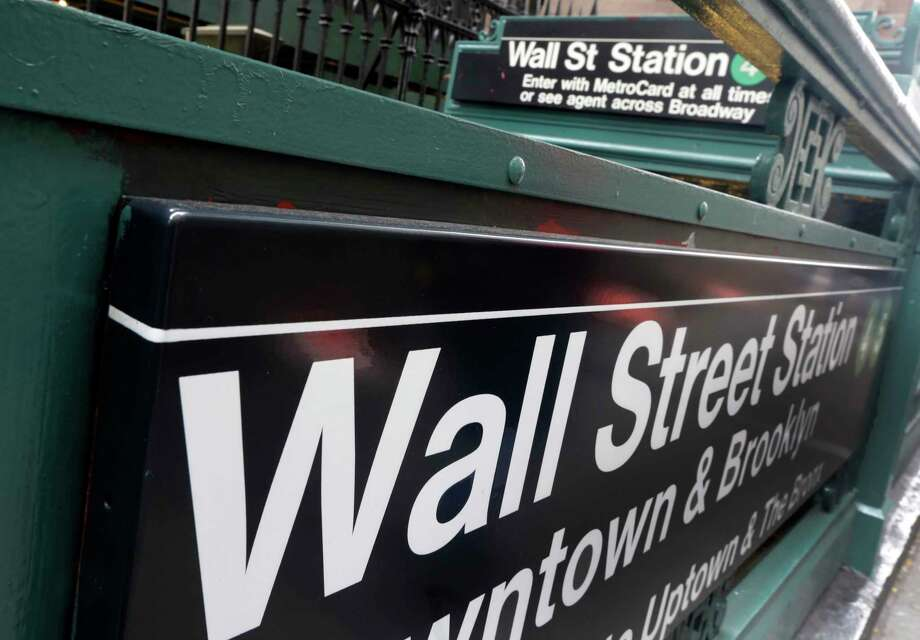 FILE- In this Oct. 2, 2014, file photo, the Wall Street subway stop on Broadway, in New York's Financial District. The U.S. stock market opens at 9:30 a.m. EST on Wednesday, Feb. 21, 2018. (AP Photo/Richard Drew, File) Photo: Richard Drew / Copyright 2016 The Associated Press. All rights reserved. This m