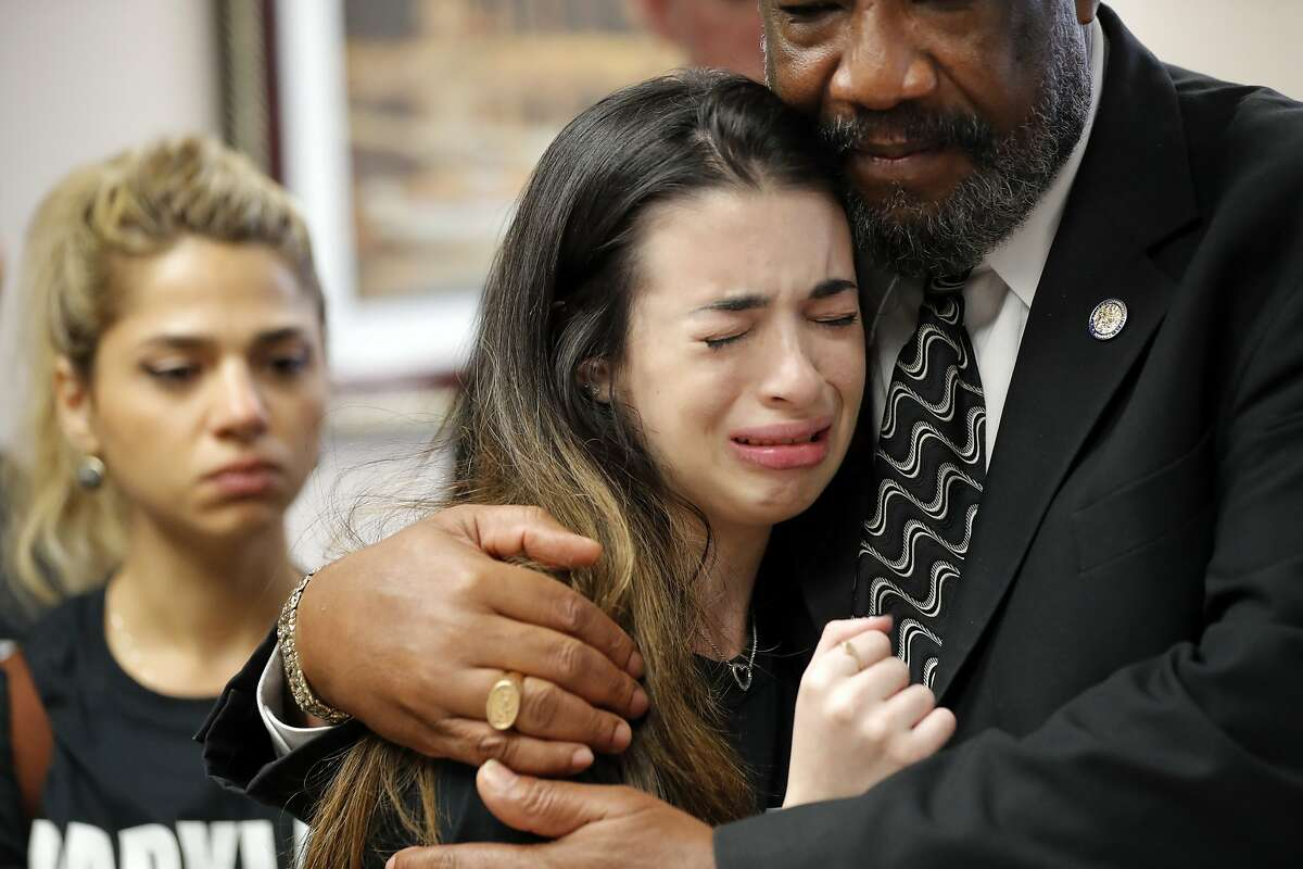 Aria Siccone, 14, a 9th grade student survivor from Marjory Stoneman Douglas High School, where more than a dozen students and faculty were killed in a mass shooting on Wednesday, cries as she recounts her story from that day, while state Rep. Barrinton Russell, D-Dist. 95, comforts her, as they talk to legislators at the state Capitol regarding gun control legislation.
