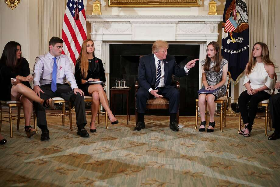 US President Donald Trump takes part in a listening session on gun violence with teachers and students in the State Dining Room of the White House on February 21, 2018. Trump promised more stringent background checks on gun owners Wednesday as he hosted a group of students who survived last week's mass shooting at a Florida high school. / AFP PHOTO / Mandel NGANMANDEL NGAN/AFP/Getty Images Photo: MANDEL NGAN, AFP/Getty Images