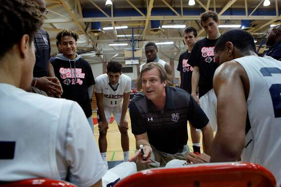 Craig McMillan talks with his starters during a time out in the second period. Longtime Santa Rosa Junior College coach Craig McMillan is having another successful season in his 18th year there.  He played with Warriors head coach Steve Kerr at Arizona in his college days.  Here McMillan guides his team to another victory against San Joaquin Delta College in Santa Rosa Friday January 26, 2018.