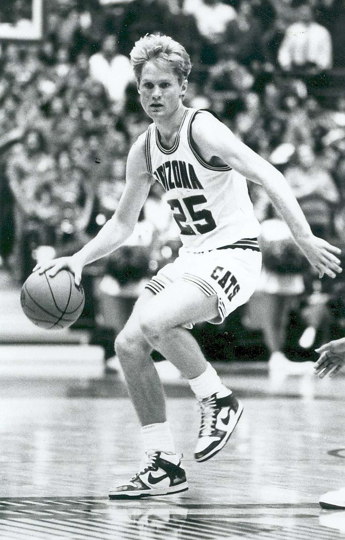 TUCSON, AZ - CIRCA 1987: Steve Kerr, #25 guard of the University of Arizona Wildcats men's basketball team drives the ball to the basket at the McKale Center in Tucson, Arizona. (Photo by Arizona/Collegiate Images/Getty Images)