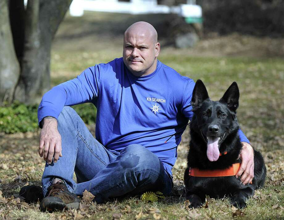 Jason Culbreth, 42, of Danbury, is raising money to train his K-9, Claymore, to become one of the few dogs capable of rescuing drowning victims. Photo: Carol Kaliff / Hearst Connecticut Media / The News-Times