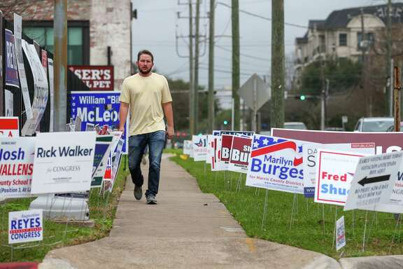 Campaign signs surround a sidewalk on West Gray Street outside the early voting station at the Metropolitan Multi-Services Center Tuesday, Feb. 20, 2018.