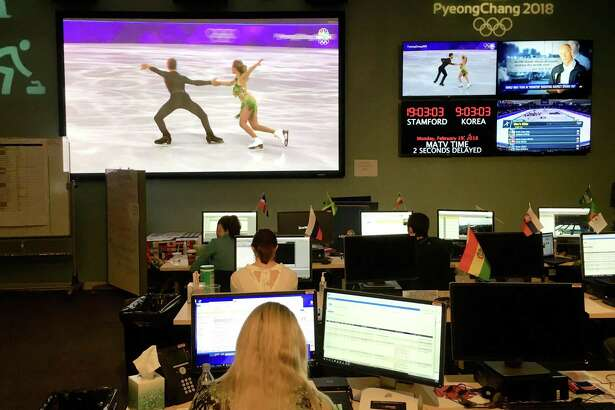 In the Stamford studios of NBC Sports, much of the effort goes toward producing highlights for digital platforms. Producers live on Korea time, shown at upper right, which is 14 hours ahead.
