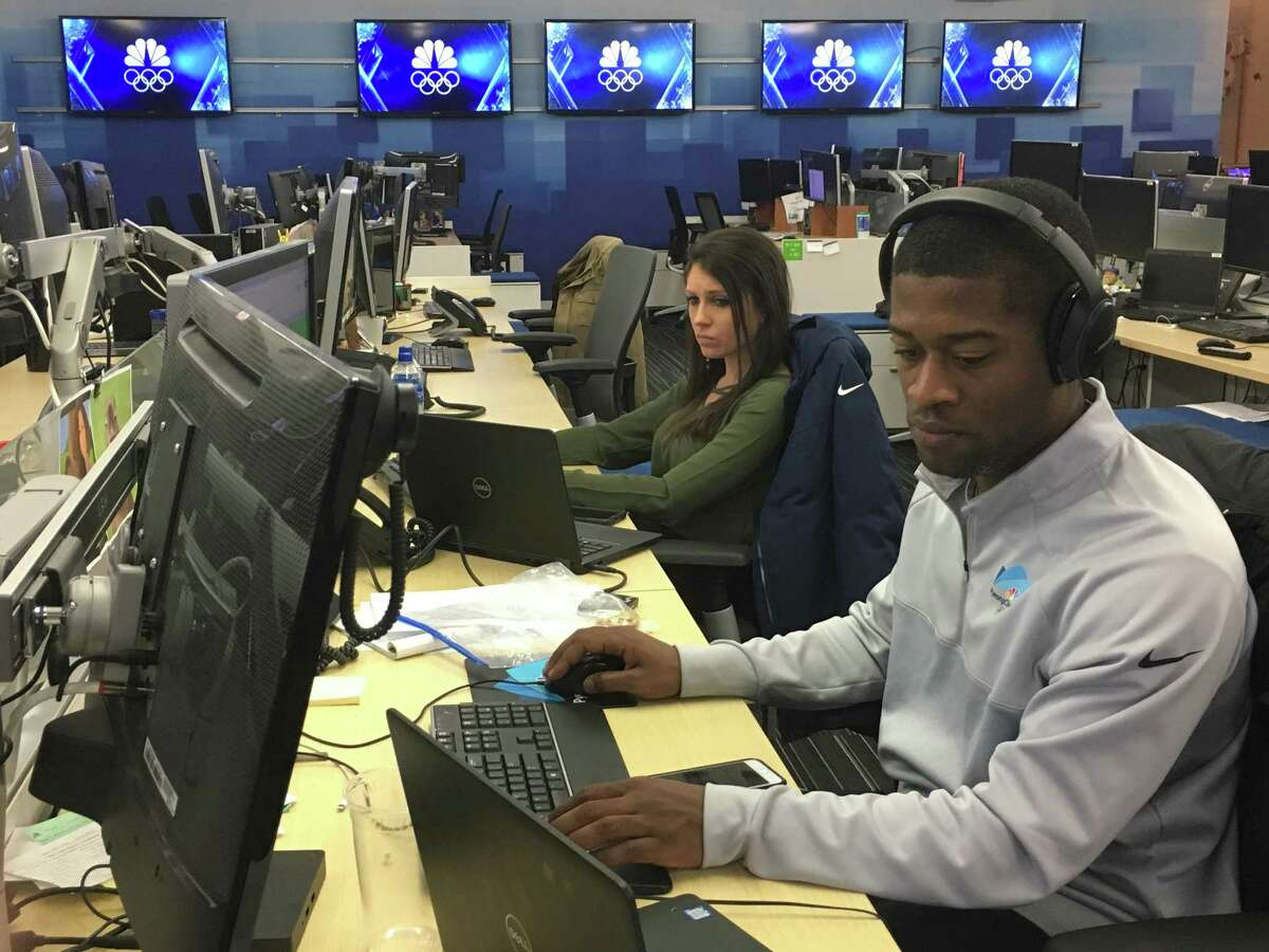 Aaron Burrell, right, of Stamford, and Meghan Smith of Milford produce video clips for NBC affiliate stations.