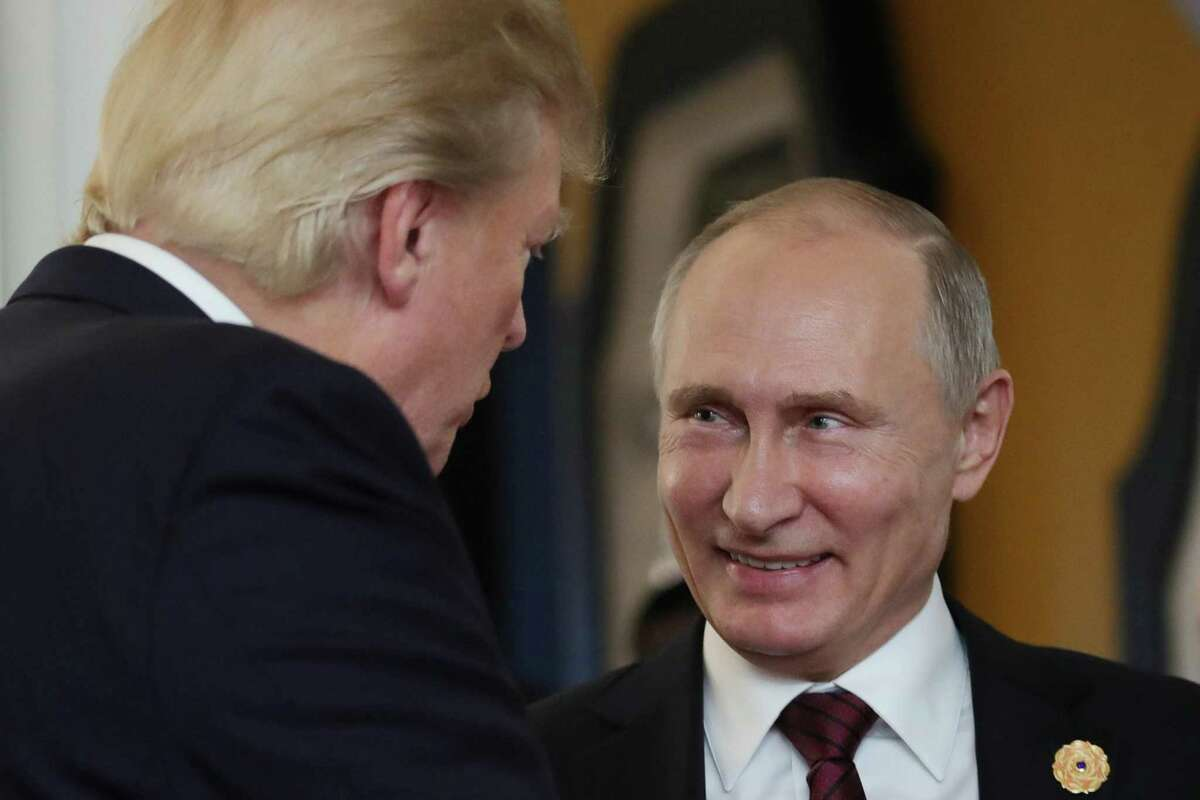 On Nov. 11, President Donald Trump chats with Russia's President Vladimir Putin as they attend the APEC Economic Leaders' Meeting, part of the Asia-Pacific Economic Cooperation (APEC) leaders' summit. In a series of tweets over the weekend, Trump attempted to discredit the investigation into Russian meddling in the U.S. election.