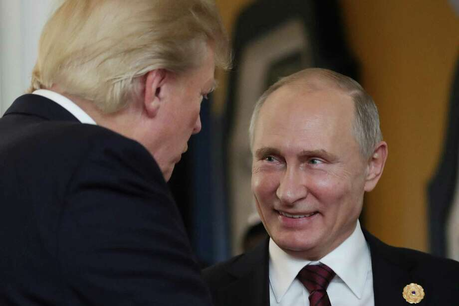 On Nov. 11, President Donald Trump chats with Russia's President Vladimir Putin as they attend the APEC Economic Leaders' Meeting, part of the Asia-Pacific Economic Cooperation (APEC) leaders' summit. In a series of tweets over the weekend, Trump attempted to discredit the investigation into Russian meddling in the U.S. election. Photo: MIKHAIL KLIMENTYEV /AFP /Getty Images / AFP