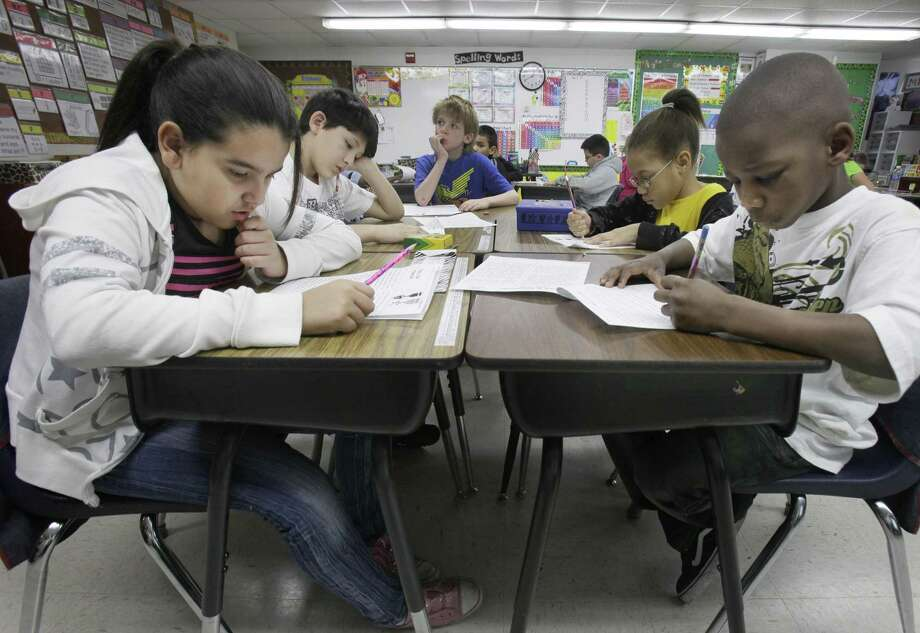 Third grade students do school work during class at Hanby Elementary School in Mesquite in 2011. Still too many Latinas are being told that their role should be one of just supporting others in the family rather than excelling in school and in careers. Photo: LM Otero /AP / AP