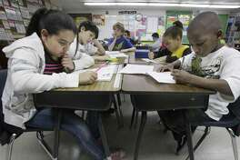 Third grade students do school work during class at Hanby Elementary School in Mesquite in 2011. Still too many Latinas are being told that their role should be one of just supporting others in the family rather than excelling in school and in careers.