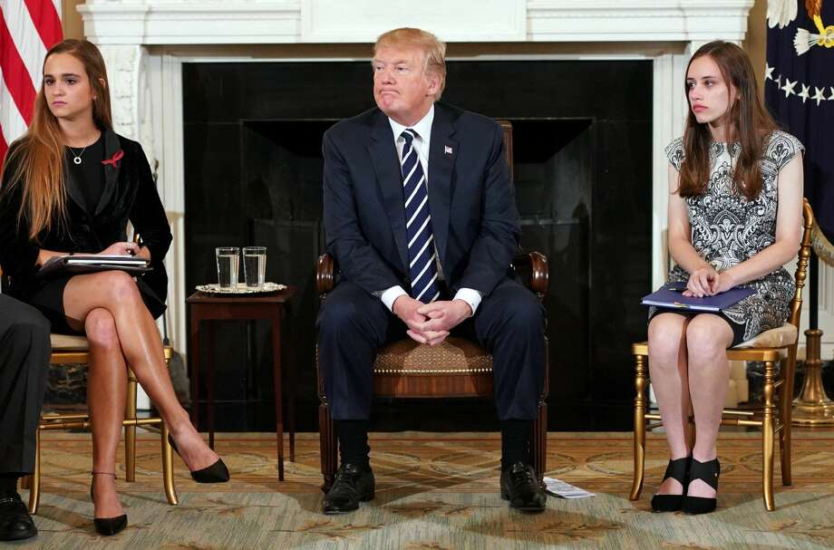 US President Donald Trump takes part in a listening session on gun violence with teachers and students in the State Dining Room of the White House on February 21, 2018. Trump promised more stringent background checks on gun owners Wednesday as he hosted a group of students who survived last week's mass shooting at a Florida high school. / AFP PHOTO / Mandel NGANMANDEL NGAN/AFP/Getty Images Photo: MANDEL NGAN/AFP/Getty Images