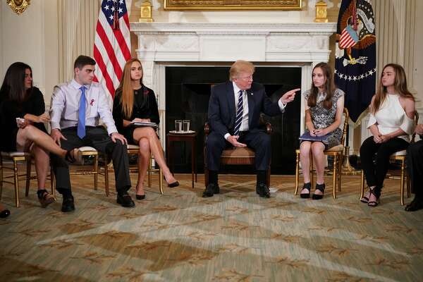 US President Donald Trump takes part in a listening session on gun violence with teachers and students in the State Dining Room of the White House on February 21, 2018. Trump promised more stringent background checks on gun owners Wednesday as he hosted a group of students who survived last week's mass shooting at a Florida high school. / AFP PHOTO / Mandel NGANMANDEL NGAN/AFP/Getty Images