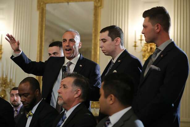 Andrew Pollack, whose daughter Meadow Pollack was shot to death last week at Marjory Stoneman Douglas High School, is joined by his sons as he addresses a listening session with U.S. President Donald Trump in the State Dining Room at the White House February 21, 2018 in Washington, DC. Trump is hosting the session in the wake of last week's mass shooting at Marjory Stoneman Douglas High School in Parkland, Florida, that left 17 students and teachers dead.
