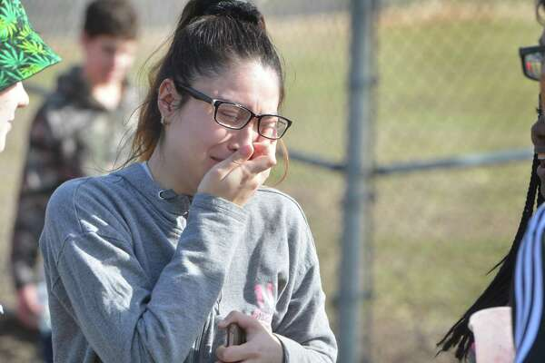 """Norwalk High School junior Yuliana Saborio meets up with friends and gets emotional after students were released from a """"shelter alert"""" at the shool due to a report of a weapon on Tuesday February 20, 2018 in Norwalk Conn. Police responded to the school to investigate the report and  released the students for ealy dismissal at 1:30pm"""