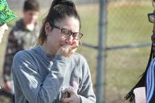 "Norwalk High School junior Yuliana Saborio meets up with friends and gets emotional after students were released from a ""shelter alert"" at the shool due to a report of a weapon on Tuesday February 20, 2018 in Norwalk Conn. Police responded to the school to investigate the report and  released the students for ealy dismissal at 1:30pm"