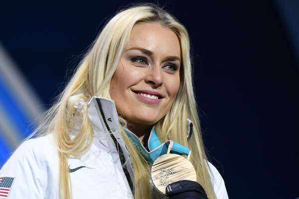 TOPSHOT - USA's bronze medallist Lindsey Vonn poses on the podium during the medal ceremony for the alpine skiing Women's Downhill at the Pyeongchang Medals Plaza during the Pyeongchang 2018 Winter Olympic Games in Pyeongchang on February 21, 2018. / AFP PHOTO / JAVIER SORIANOJAVIER SORIANO/AFP/Getty Images