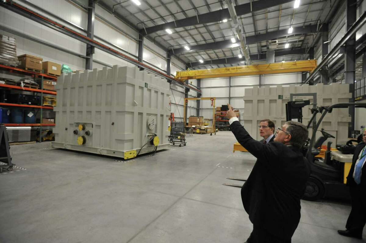 U.S. Sen. Richard Blumenthal, D-Connecticut, visited FuelCell Energy in Torrington Wednesday to discuss a fresh tax credit for the industry and tour the recently-expanded factory. Above, FuelCell Senior Vice President and Chief Operating Officer Tony Rauseo guides Blumenthal through the facility.