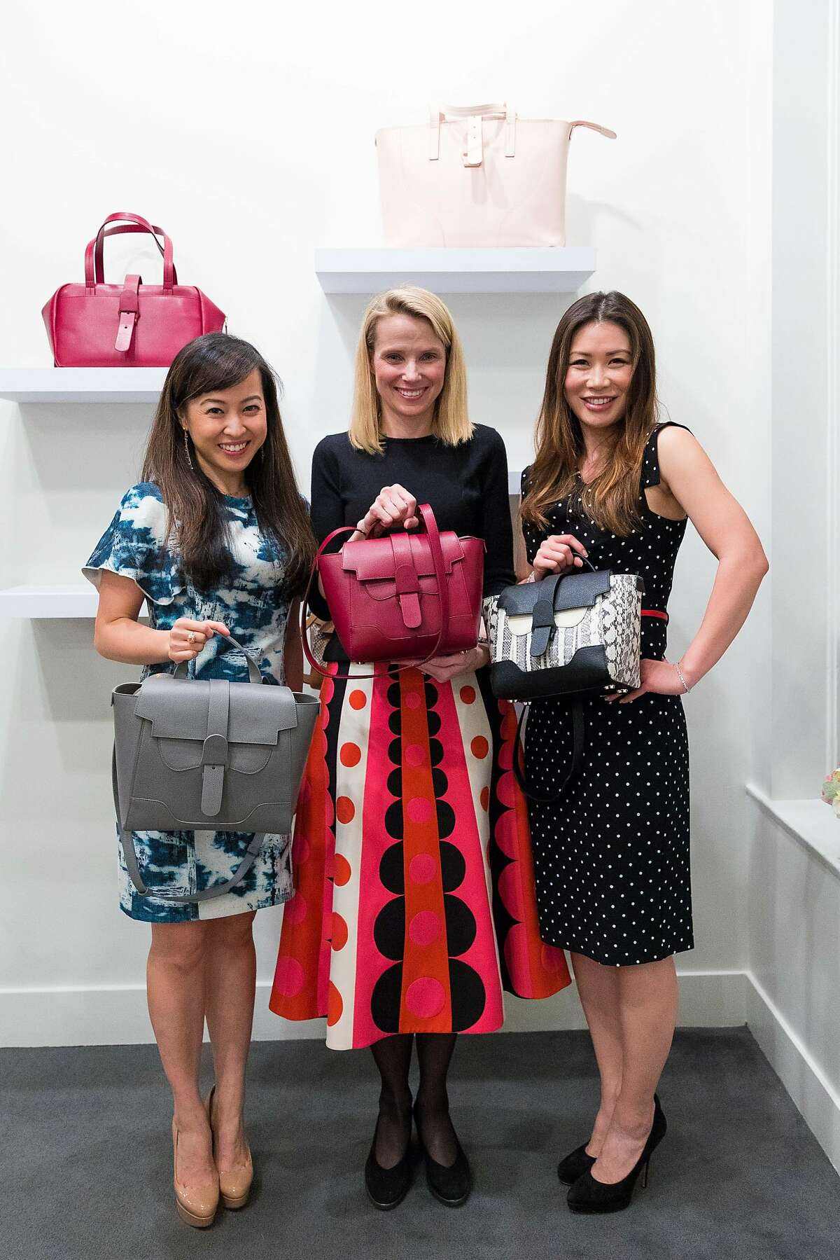 San Francisco bag company Senreve has opened a by-appointment showroom in Union Square.�Founders�Coral Chung (left) and Wendy Wen flank former Yahoo CEO Marissa Mayer, who attended the opening party.