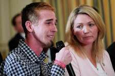 Marjory Stoneman Douglas High School shooting survivor Samuel Zeif (L) speaks during a listening session on gun violence with US President Donald Trump, teachers and students in the State Dining Room of the White House on February 21, 2018. At right is Nicole Hockley, parent of a Sandy Hook shooting victim.