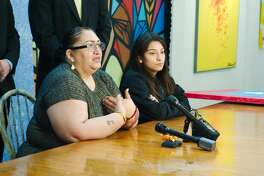 Mirna Garcia sits with her daughter Pasadena Memorial High School student Jazmin Gaciaas she makes statement during a press conference Wednesday Feb 21.