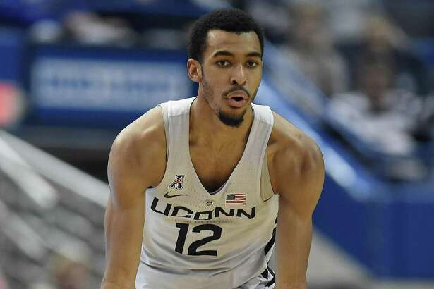UConn's Tyler Polley gestures after making a basket during the first half against Tulsa on Feb. 15.