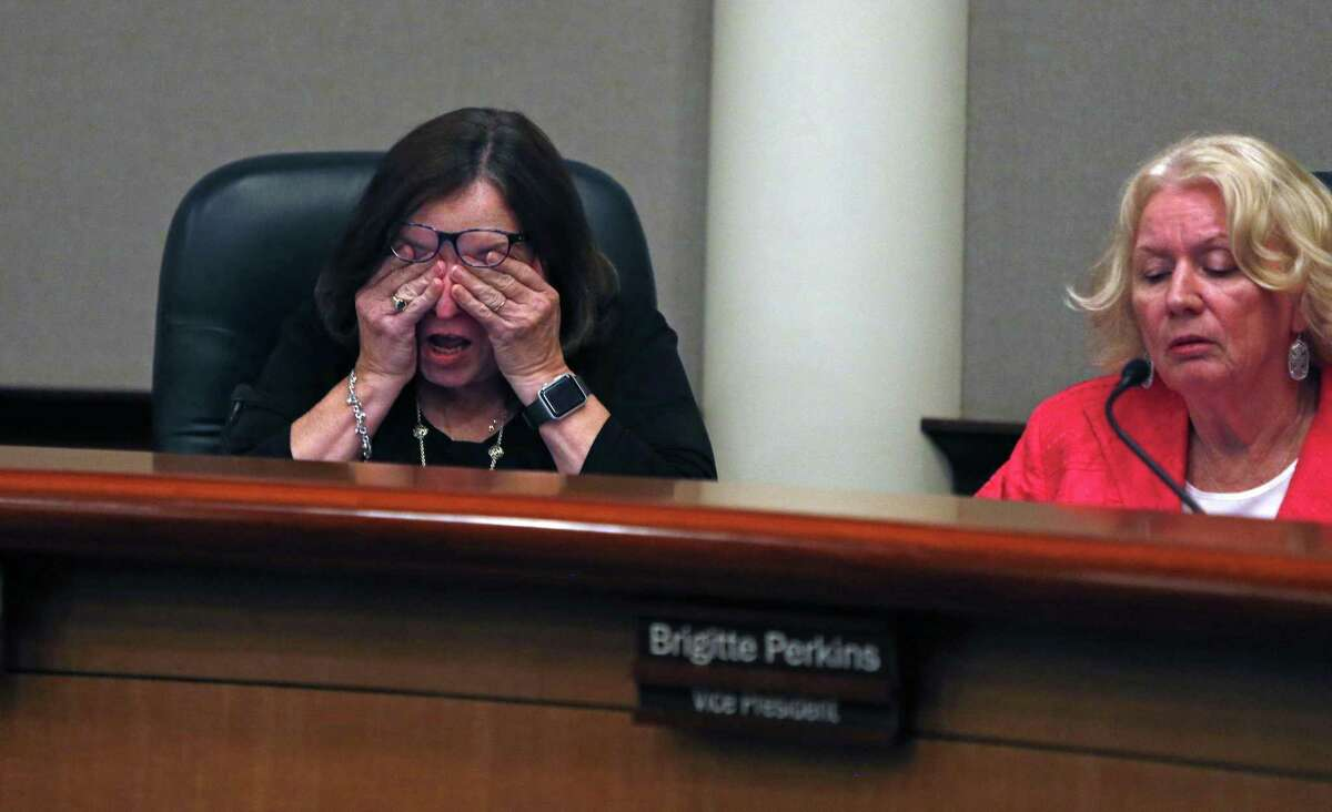 An emotional Sandy Hughey, left, and fellow NEISD trustee Brigitte Perkins, during a school board debate last August over whether to change the name of Robert E. Lee High School in the wake of the events in Charlottesville, Virginia and the national debate it renewed about Confederate monuments.