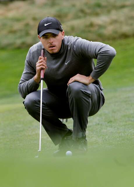 Joseph Bramlett has a look at his birdie putt on the 14th hole at Spyglass Hill, which he made during the third round of the 2012 AT&T Pebble Beach National Pro-Am Golf Tournament, in Pebble Beach, Ca. on Saturday Feb. 11, 2012. Photo: Michael Macor, SFC