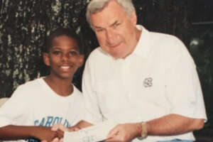 Chris Paul as a kid with the legendary Dean Smith at a North Carolina basketball camp.