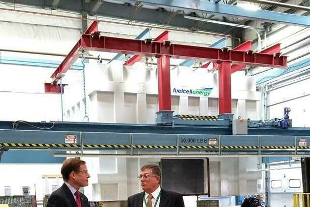 U.S. Sen. Richard Blumenthal, left, and Tony Rauseo, chief operating officer of Danbury-based FuelCell Energy, tour  the company's manufacturing plant in Torrington  Wednesday