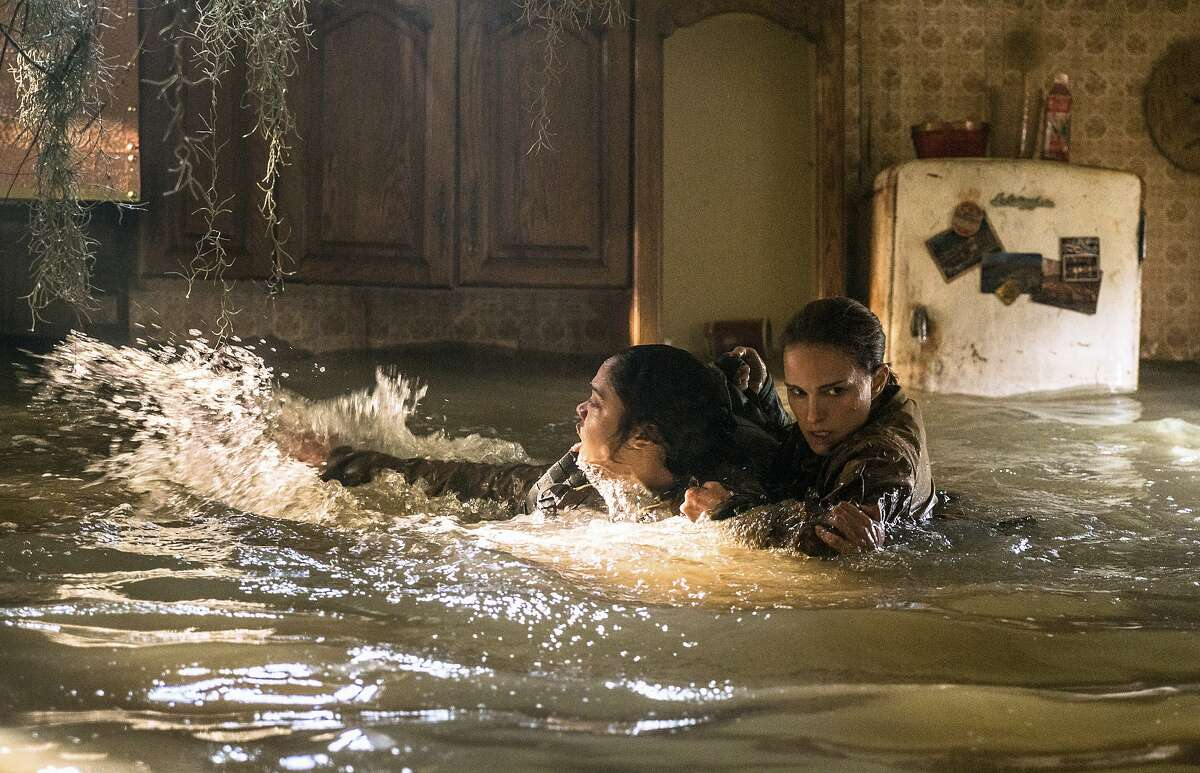 """This image released by Paramount Pictures shows Tessa Thompson and Natalie Portman in a scene from """"Annihilation."""" (Peter Mountain/Paramount Pictures/Skydance via AP)"""