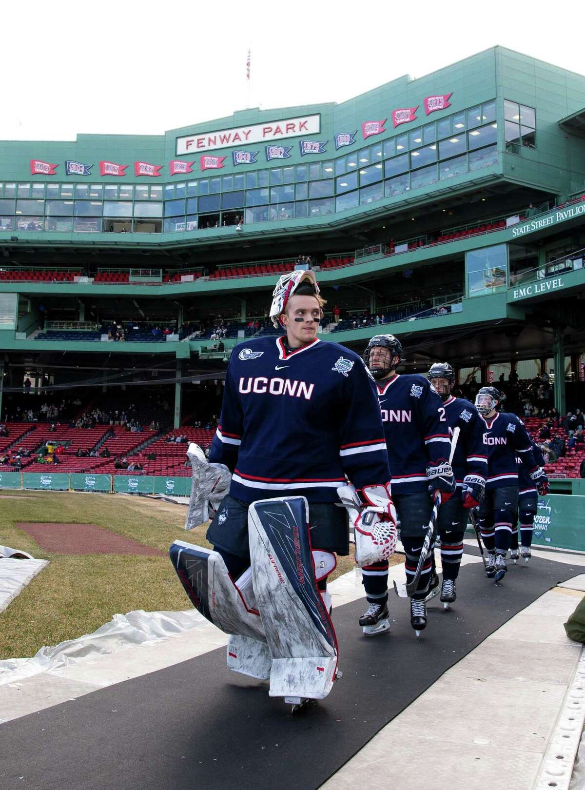 """BOSTON, MA - JANUARY 14: Tanner Creel #1 of the Connecticut Huskies walks towards the ice surface during an NCAA hockey game against the Maine Black Bears at Fenway Park during """"Frozen Fenway"""" on January 14, 2017 in Boston, Massachusetts. The Black Bears won 4-0. (Photo by Richard T Gagnon/Getty Images)"""