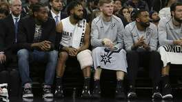 Spurs' Kawhi Leonard (from left) sits on the bench with teammates Patty Mills, Davis Bretons, Darrun Hilliard and Joffrey Lauvergne during the game against the Cleveland Cavaliers at the AT&T Center on Tuesday, Jan. 23, 2018. (Kin Man Hui/San Antonio Express-News)