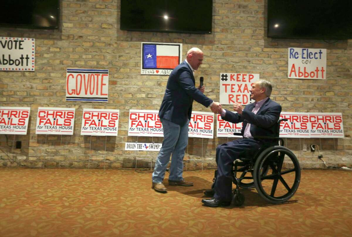 Then-Hollywood Park Mayor Chris Fails, then a primary challenger seeking to unseat state Rep. Lyle Larson, shakes hands with Gov. Greg Abbott in 2018.