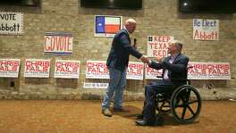 Candidate for State House district 122 Chris Fails, left, shakes hands with Gov. Greg Abbott Wednesday, Feb. 21, 2018 as the governor campaigns for Fails in San Antonio.
