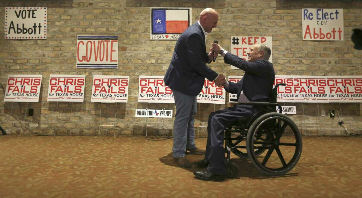 Candidate for State House district 122 Chris Fails, left, greets Gov. Greg Abbott Feb. 21 at Alamo Cafe as the governor campaigns for Fails in San Antonio. Fails was challenging GOP incumbent Lyle Larson of San Antonio in the primary. Larson won.