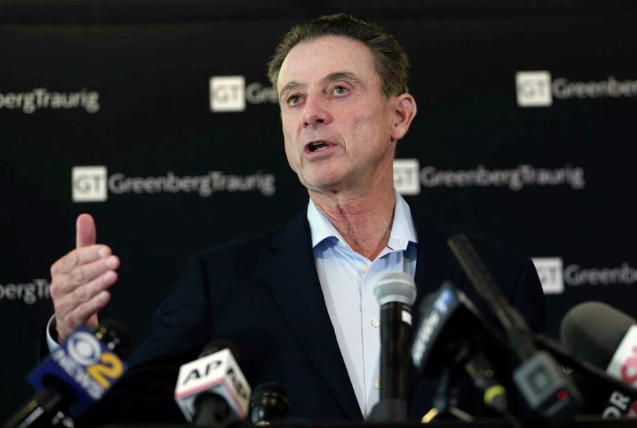 Former Louisville basketball coach Rick Pitino talks to reporters during a news conference in New York, Wednesday, Feb. 21, 2018. Pitino helds the news conference in the wake of an NCAA decision in a sex scandal case that strips the Cardinals program of 123 victories, a national championship and $600,000 in post-season revenue. (AP Photo/Seth Wenig) Photo: Seth Wenig / AP