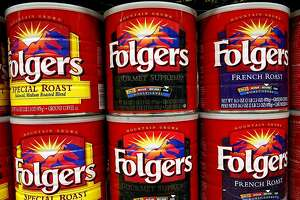 PALO ALTO, CA - JULY 22:  Cans of Folgers Coffee are seen on the shelf at Andronico's Market July 22, 2003 in Palo Alto, California. In a cost cutting measure, Folgers, the nation's largest coffee purveyor, will discontinue using its metal cans starting in September 2003, and will switch to an airtight plastic container with a valve for pouring that keeps ground beans fresh.  (Photo by Justin Sullivan/Getty Images)
