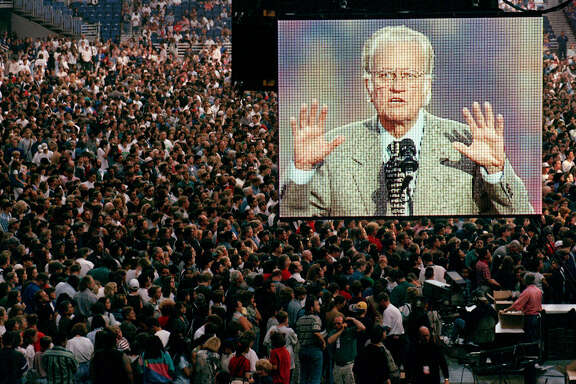 A video screen displays Billy Graham at a San Antonio crusade event.