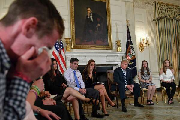 Samuel Zeif, student at Marjory Stoneman Douglas High School, left, weeps after recounting his story of the shooting incident at his high school as other students and teachers listen, including President Trump during an event at the White House Wednesday.